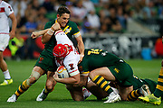 Chris Hill of England gets tackled by Billy Slater of Australia during the Rugby League World Cup match between Australia and England at Melbourne Rectangular Stadium, Melbourne, Australia on 27 October 2017. Photo by Mark  Witte.