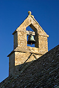 Bell tower of St Oswald's Church in Widford, Oxfordshire,  UK