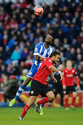 Wigan Defender Emmerson Boyce (BRB) and Cardiff Defender Cala (ESP) compete in the air - Photo mandatory by-line: Rogan Thomson/JMP - 07966 386802 - 15/02/2014 - SPORT - FOOTBALL - Cardiff City Stadium - Cardiff City v Wigan Athletic - The FA Cup Fifth Round Proper.