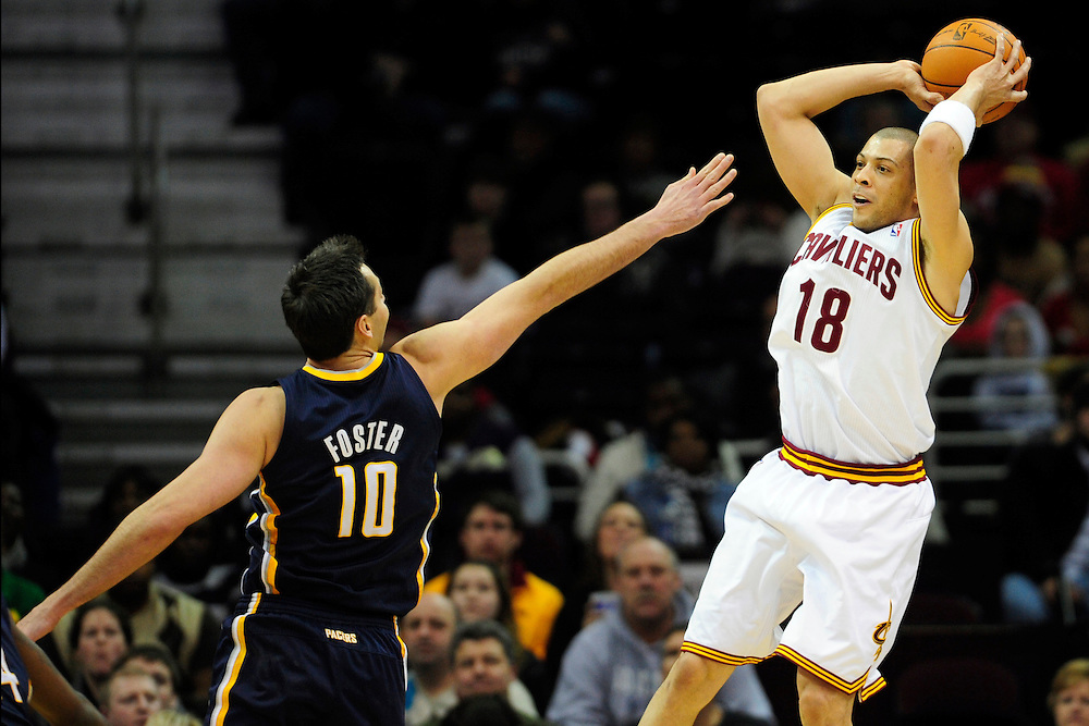 Feb. 2, 2011; Cleveland, OH, USA; Cleveland Cavaliers shooting guard Anthony Parker (18) looks for a pass over Indiana Pacers center Jeff Foster (10) during the third quarter at Quicken Loans Arena. The Pacers beat the Cavaliers 117-112. Mandatory Credit: Jason Miller-US PRESSWIRE