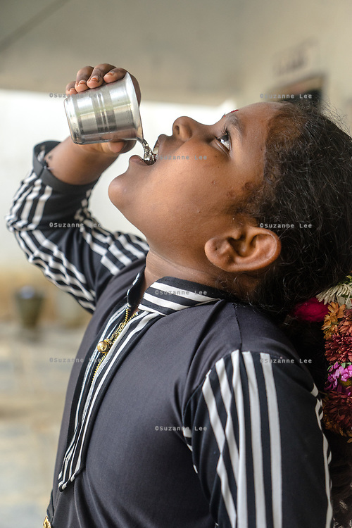 A student drinks Safe Water Network iJal water at a school in village Gorikothapally, Telangana, Indiia, on Friday, February 8, 2019. Photographer: Suzanne Lee for Safe Water Network