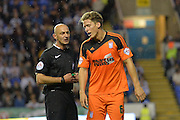 The referee has a word with Ipswich Town defender Christophe Berra during the Sky Bet Championship match between Reading and Ipswich Town at the Madejski Stadium, Reading, England on 11 September 2015. Photo by Mark Davies.