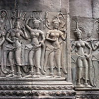 Stone-carving representing 6 Apsaras on a wall at Angkor Wat. In the Buddhist and Hindu mythology the Apsara is a divine spirit with superior knowledge in the art of dancing. The classical khmer dance is still practiced today in cambodia, but also in other asian countries like in Laos or Thailand.