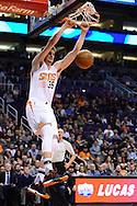 Jan 3, 2017; Phoenix, AZ, USA;  Phoenix Suns forward Dragan Bender (35) dunks the ball in the first half of the NBA game against the Miami Heat at Talking Stick Resort Arena. Mandatory Credit: Jennifer Stewart-USA TODAY Sports