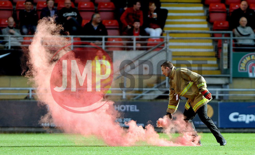 Flare removed from pitch - photo mandatory by-line David Purday JMP- Tel: Mobile 07966 386802 - 04/10/14 - Leyton Orient  v Swindon Town - SPORT - FOOTBALL - Sky Bet Leauge 1  - London -  Matchroom Stadium