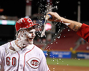 Wednesday, Sept. 12, 2012  REDS SPORTS  : Cincinnati Reds relief pitcher J.J. Hoover (60) is doused in beer and shaving cream by teammate Mat Latos after pitching for his first major league save against the Pittsburgh Pirates after their game at Great American Ball Park. The Enquirer/Jeff Swinger