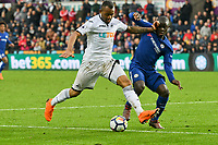Football - 2017 / 2018 Premier League - Swansea City vs. Chelsea<br /> <br /> Jordan Ayew of Swansea City & N'Golo Kanté of Chelsea contest the ball, at the Liberty Stadium.<br /> <br /> <br /> COLORSPORT/WINSTON BYNORTH