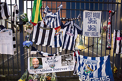 © Licensed to London News Pictures. 30/01/2018. The funeral of footballer Cyrille Regis took place in West Bromwich today. The hearse made it's way past the football ground where he played as family, friends and fans said their final farewell. Tributes outside left by fans. Photo credit: Dave Warren/LNP