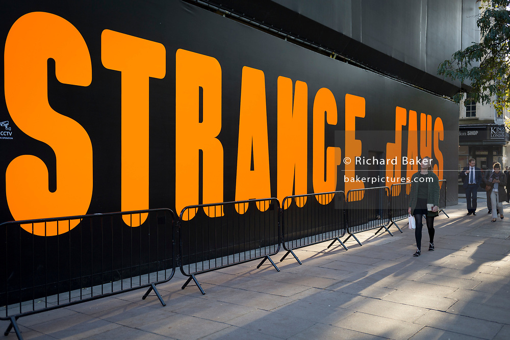 The words Strange Days are written in large orange lettering as part of Strange Days, an video arts exhibition, on 3rd October 2018, in London, England. 'Strange Days: Memories of the Future', is a new exhibition presented by New York's New Museum and The Store X in partnership with The Vinyl Factory, at London's The Store X, 180 The Strand. The Massimiliano Gioni-curated exhibition features work by some of the world's most exciting film-makers and video artists, presented as large-scale, multi-screen video installations, many of which are being shown in the UK for the first time.