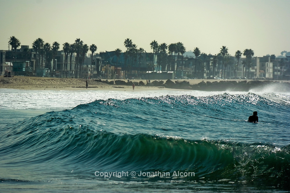 Waves crash on the shore at Venice Beach on another day of above average temperatures in Southern California while much of the rest of the U.S. is enduring freezing winter storms.