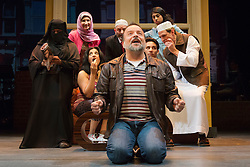 """© Licensed to London News Pictures. 08/10/2014. London, England. Kev Orkian as Mahmoud at the front. The Musical """"The Infidel"""", based on the same named film by David Baddiel,  premieres at the Theatre Royal Stratford East, London. Directed by David Baddiel and Kerry Michael, book and lyrics by David Baddiel with music by Erran Baron Cohen. The Infidel is a story about Muslim man Mahmoud (Kev Orkian) who discovered that he is not only adopted but also Jewish. Photo credit: Bettina Strenske/LNP"""