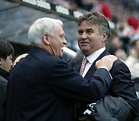 Photo. Andrew Unwin.<br /> Newcastle United v PSV Eindhoven, UEFA Cup Quarter Final Second Leg, St James' Park, Newcastle upon Tyne 14/04/2004.<br /> Newcastle's Sir Bobby Robson (l) and PSV's Guus Hiddink (r) exchange words before the match.