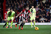 Brentford midfielder Alan Judge scoring a penalty and his second of the game during the Sky Bet Championship match between Brentford and Huddersfield Town at Griffin Park, London, England on 19 December 2015. Photo by Matthew Redman.