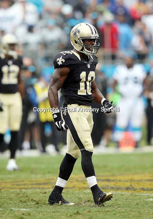 New Orleans Saints wide receiver Brandin Cooks (10) yells in celebration after catching a fourth quarter pass for a gain of 16 yards and a first down close to the two minute warning during the 2015 NFL week 3 regular season football game against the Carolina Panthers on Sunday, Sept. 27, 2015 in Charlotte, N.C. The Panthers won the game 27-22. (©Paul Anthony Spinelli)