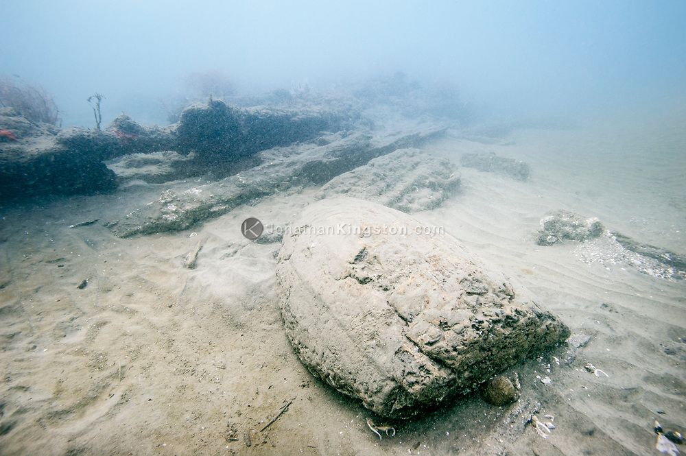 A wooden barrel lies partially buried in sand on the ocean floor off the port side of the 17th century shipwreck Encarnación discovered during an expedition searching for Henry Morgan's lost fleet of 1671 in Panama.