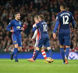 Manchester United's Wayne Rooney pulls away Arsenal's Jack Wilshere from the incident with Manchester United's Marouane Fellaini - Photo mandatory by-line: Alex James/JMP - Mobile: 07966 386802 - 22/11/2014 - Sport - Football - London - Emirates Stadium - Arsenal v Manchester United - Barclays Premier League