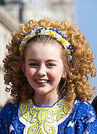 A young Irish dancer smiles for the camera before the start of the St Patrick's Day Parade in Westminster, London.<br /> Picture by Paul Davey/Focus Images Ltd +447966 016296<br /> 13/03/2016