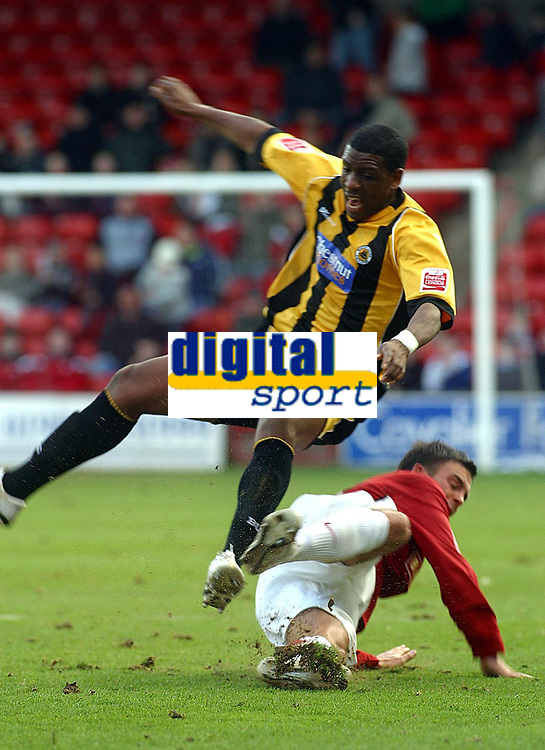 Photo: Dave Linney.<br />Walsall v Boston United. Coca Cola League 2. 27/01/2007.<br />Walsall's Daniel Fox(Bottom) gets in a fierce tackle on Justin Richards