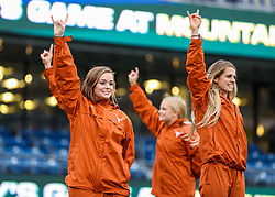 Nov 18, 2017; Morgantown, WV, USA; Texas Longhorns cheerleaders celebrate after beating the West Virginia Mountaineers at Milan Puskar Stadium. Mandatory Credit: Ben Queen-USA TODAY Sports