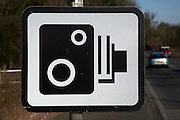 Speed camera sign by side of main road