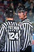 KELOWNA, CANADA - DECEMBER 3: Linesman Bevan Mills speaks to linesman Ward Patement on December 3, 2014 at Prospera Place in Kelowna, British Columbia, Canada.  (Photo by Marissa Baecker/Shoot the Breeze)  *** Local Caption *** Bevan Mills; Ward Pateman;