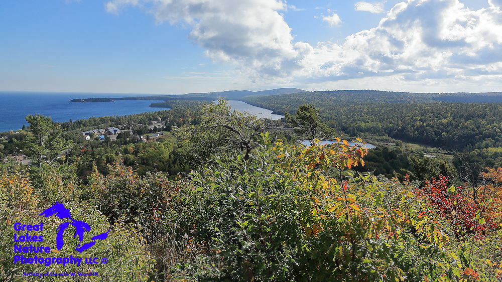 From the Brockway Mountain overlook, the little town of Copper Harbor is nestled between Lake Fanny Hooe and Lake Superior. In the distance lies a vast wilderness that remains undeveloped and accessible only to four-wheel-drive vehicles or ATVs.