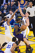 Golden State Warriors guard Klay Thompson (11) and guard Ian Clark (21) double team the Charlotte Hornets offense at Oracle Arena in Oakland, Calif., on February 1, 2017. (Stan Olszewski/Special to S.F. Examiner)