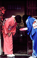 Traditional Japanese greeting, guest presenting hostess a gift, Kyoto, Japan