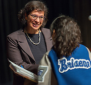 Sonia Nazario talks with a student after a presentation at Chavez High School, September 26, 2014.