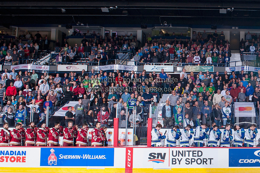 REGINA, SK - MAY 19: The Swift Current Broncos and the Acadie-Bathurst Titan stand on the bench during the national anthem at the Brandt Centre on May 19, 2018 in Regina, Canada. (Photo by Marissa Baecker/CHL Images)
