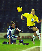Photo: Paul Greenwood.<br />Bury v Hereford United. Coca Cola League 2. 30/01/2007. Hereford's Simon Travis, right, clears past Tom Kennedy