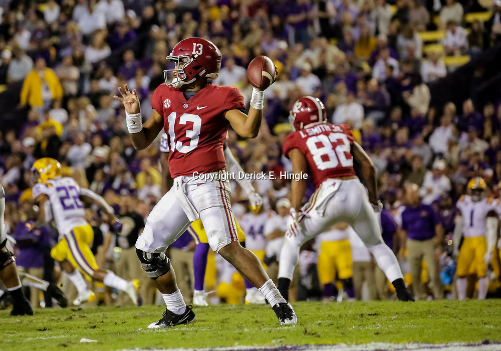 Nov 3, 2018; Baton Rouge, LA, USA; Alabama Crimson Tide quarterback Tua Tagovailoa (13) throws against the LSU Tigers during the third quarter at Tiger Stadium. Mandatory Credit: Derick E. Hingle-USA TODAY Sports