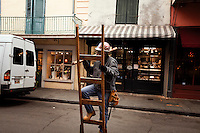 Street performer does his act on Royal Street, in French Quarter of New Orleans, LA.  Copyright 2011 Reid McNally