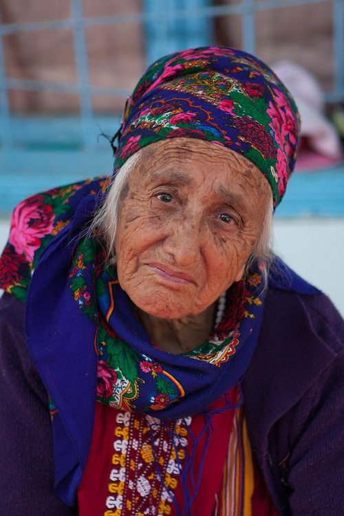 An old woman in the courtyard of the family home, Nokhur village