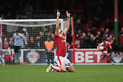 Swindon Town defender Raphael Rossi-Branco celebrates Swindon Town striker Nicky Ajose's penalty during the Sky Bet League 1 match between Swindon Town and Coventry City at the County Ground, Swindon, England on 24 October 2015. Photo by Jemma Phillips.