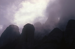 Bleak and wild mountain tops bathed in cloud at Montserrat; Catalunya,