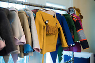 Children's jackets hang around Molly Goodall's home where she designs and sells them in McKinney, Texas on September 11, 2015. (Cooper Neill for The New York Times)