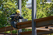Ironworker assembling the steel framework of a building.