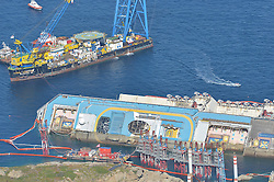 60484304 Isola del Giglio, Italy. Work begins today to right the stricken Costa Concordia vessel, which sank on January 12, 2012. If the operation is successful, it will then be towed away and scrapped. The procedure, known as parbuckling, has never been carried out on a vessel as large as Costa Concordia before, Italy, Monday September 16, 2013.<br /> Picture by imago / i-Images<br /> UK ONLY