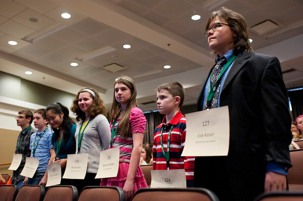 Spelling bee participants stand as they are giving a round of applause for competing in the Southeast Ohio Regional Spelling Bee Saturday, March 16, 2013.