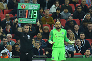 Wilfredo Caballero (13) of Chelsea looks bemused as he waits to come on as Kepa Arrizabalaga (1) of Chelsea refuses to be substituted during the Carabao Cup Final match between Chelsea and Manchester City at Wembley Stadium, London, England on 24 February 2019.