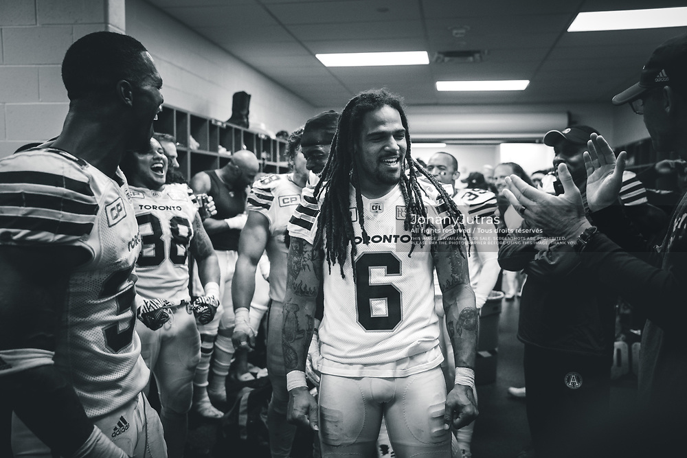 Marcus Ball (6), James Wilder Jr. (32), Dylan Wynn (98), SJ Green (19), head coach Marc Trestman, defensive coordinator Corey Chamblin and members of the Toronto Argonauts celebrates in the locker room after the win against the Hamilton Tiger-Cats at Tim Horton's Field in Hamilton, ON, Saturday, September 30, 2017. (Photo: Johany Jutras)