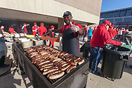 A Union employee grills up hundreds of brats for the Homecoming Badger Bash celebration at Union South in 2014.