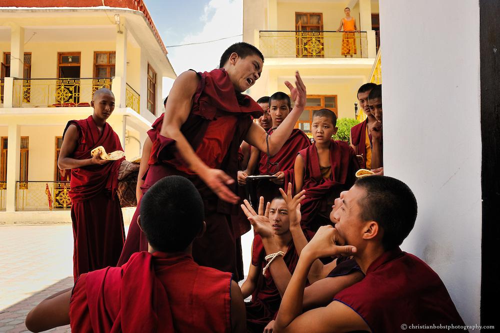 Tibetan novice monks are debating at the Dagpo Shedrub Ling Monastery in Kullu Valley, India