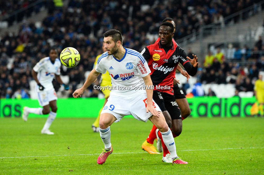 Andre Pierre GIGNAC / Benjamin ANGOUA - 18.01.2015 - Marseille / Guingamp - 21eme journee de Ligue 1 -<br />Photo : Gaston Petrelli / Icon Sport