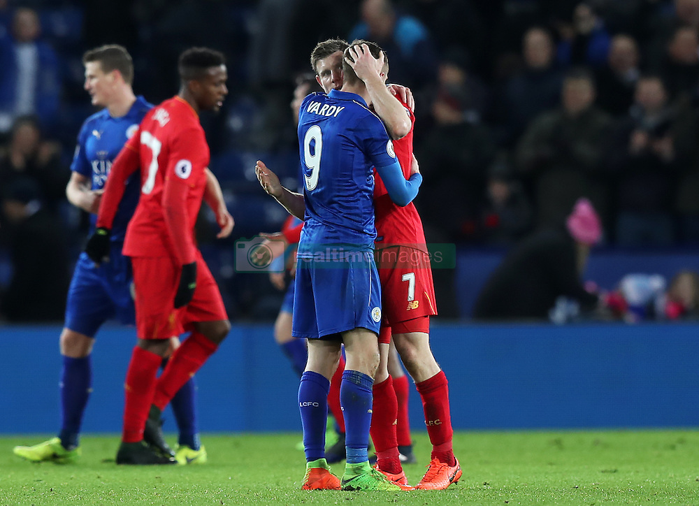 Leicester City's Jamie Vardy (left) and Liverpool's James Milner embrace after the game