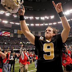 2009 November 30: New Orleans Saints quarterback Drew Brees (9) celebrates following a 38-17 win by the New Orleans Saints over the New England Patriots at the Louisiana Superdome in New Orleans, Louisiana.