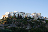 view from below of Sperlonga on a rock with historic houses