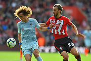 David Luiz (30) of Chelsea battles for possession with Manolo Gabbiadini (20) of Southampton during the Premier League match between Southampton and Chelsea at the St Mary's Stadium, Southampton, England on 7 October 2018.