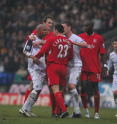 BOLTON, ENGLAND - MONDAY, JANUARY 2nd, 2006: Liverpool's Jamie Carragher argues with Bolton Wanderers' El Hadji Diouf during the Premiership match at the Reebok Stadium. (Pic by Dan Istitene/Propaganda)